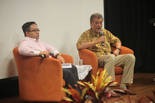 Dr Jomo responds to questions as moderator, Mr Wan Saiful Wan Jan, looks on.