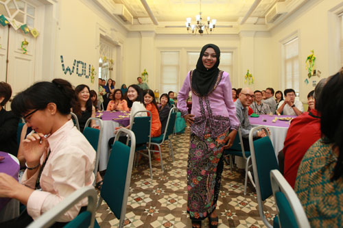 One of the students parades a colourful baju kebaya.