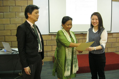 Prof Madhulika presents the Dean's List award to Jesselina Sim. At left is Kuching Regional Centre Director Jimmy Chai.