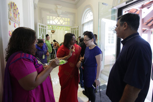 Assoc Prof Dr Wendy Bong (right) being adorned with pottu on arrival.