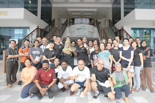 Participants of the Spartan race with colleagues from the Information Technology Services department.