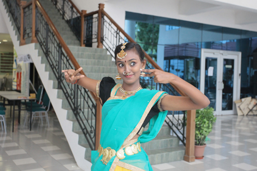 Student Priya performing an Indian classical dance.
