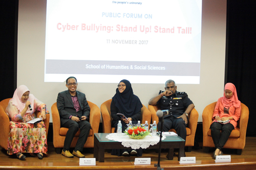 WOU Lecturer Irmadura Ramli (left) introduces the four panellists.