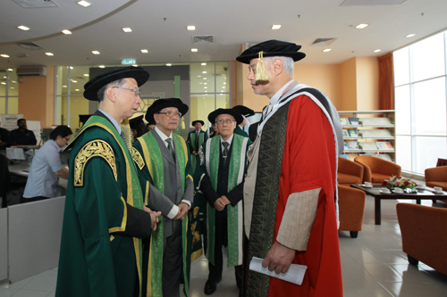 Dr Koh Tsu Koon (left) in conversation with Jomo as Prof Ho (2nd from right) and Tun Dzaiddin look on.