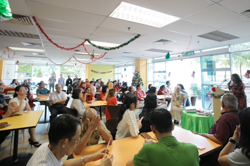 Staff gathered at the cafeteria for the Christmas event.