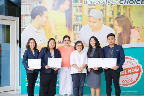 The students with their certificates as they pose with prof zoraini and grace lau.