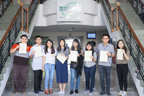 Eight of the Dean's List recipients with their certificates.