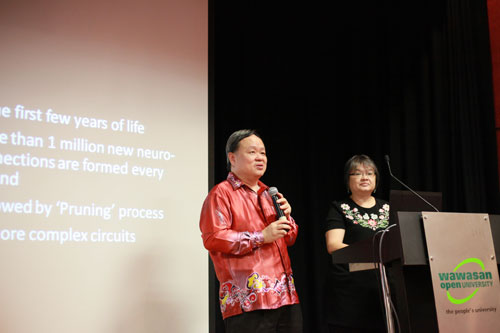 Dr Lai, who has impaired vision, is assisted in his presentation by his wife, Datin Indranee Liew.