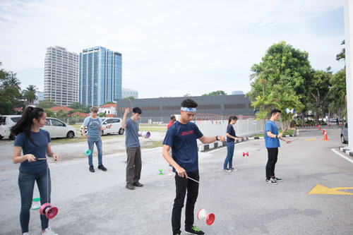 Robin Cheah (far right) and the full-time students give a thrilling diabolo performance.