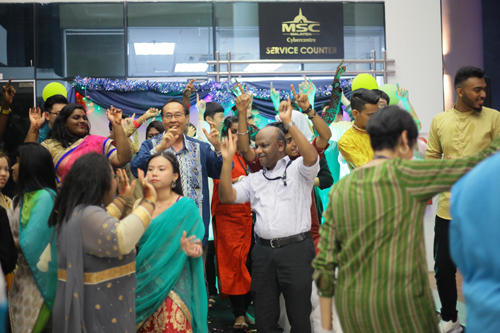 Prakash (centre) and other academics join the students for the Bhangra dance.