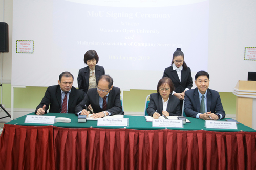 signing by tang (2nd from left) and prof zoraini (2nd from right).