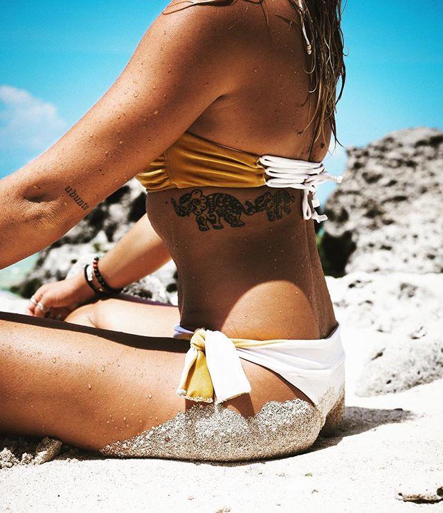 B E A C H 🏝 E S S E N T I A L S 👙💦 . . . What else do you need? Just bikini & sun ...and a little sand 😜 These golden velvet & white lycra beauties now on sale for $30/piece 🤗 #bikini #beach #island #sand #tan #tattoo #sun #glow #skin #ocean @jesseas_journal 📸 @7highseas @nunuibali