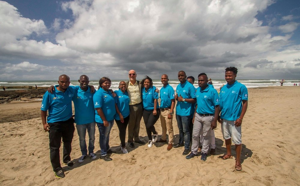 Figure 3: Minister of Tourism (Centre) with Stewards from the Tourism Blue Flag Project (clothed in blue shirts)