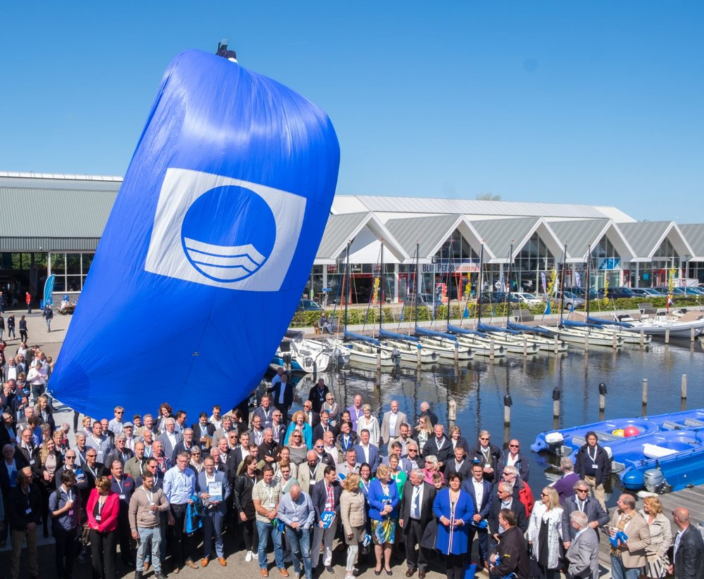 Blue Flag sail hoisted on spinnaker in celebration of 2018 Blue Flag site awarding ceremony