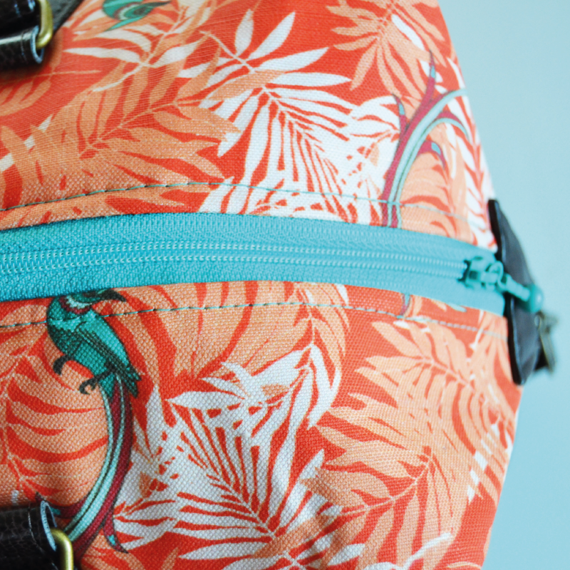 Contrasting turquoise zippers make stylish details.