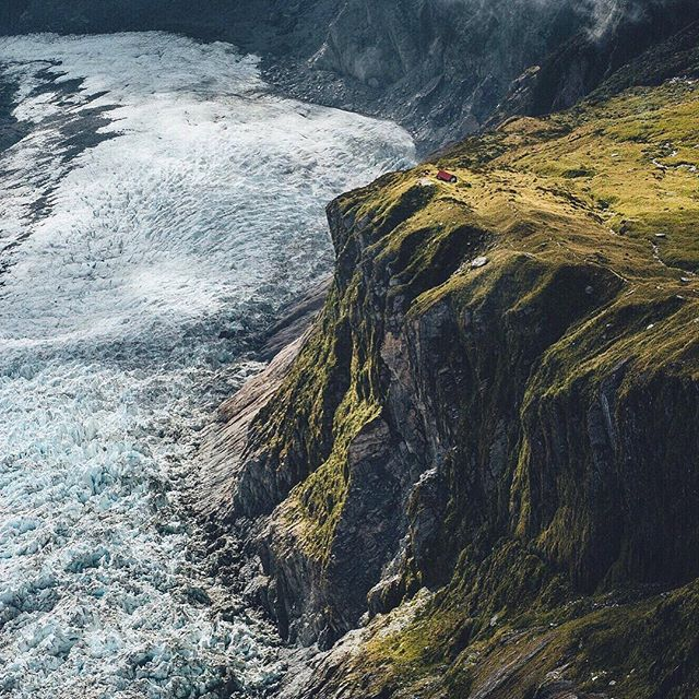 SWIPE LEFT 👈🏻👈🏻👈🏻👈🏻 The screen size doesn't justify this shot I took from the helicopter flying over Franz Josef glacier in New Zealand. @purenewzealand  Spot the little red house.. true perspective of how large this area is.