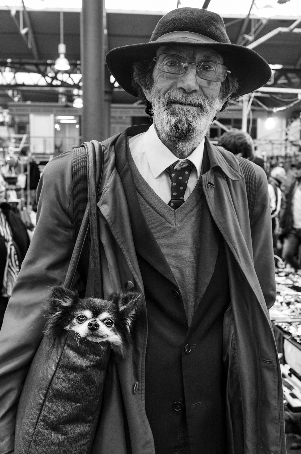 MAN WITH A  DOG IN HIS  BAG.jpg