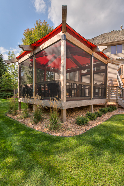 In Minnesota, pleasant summer days can feel all too fleeting, and this Plymouth family wanted another way to extend all the pleasures of the season. MA Peterson added a detached, exterior screened porch that connects to an existing, expansive deck wrapped around the back of the home.