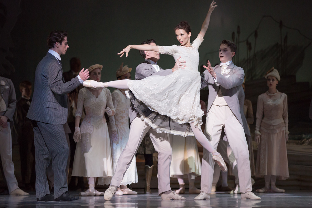 Juliet Burnett as Odette with Rudy Hawkes as Prince Siegfried and artists of The Australian Ballet