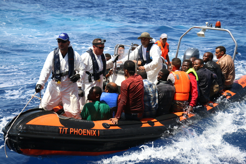 Rescuers from the Migrant Offshore Aid Station ferry stranded refugees to safety. © Ruth Pollard 2015