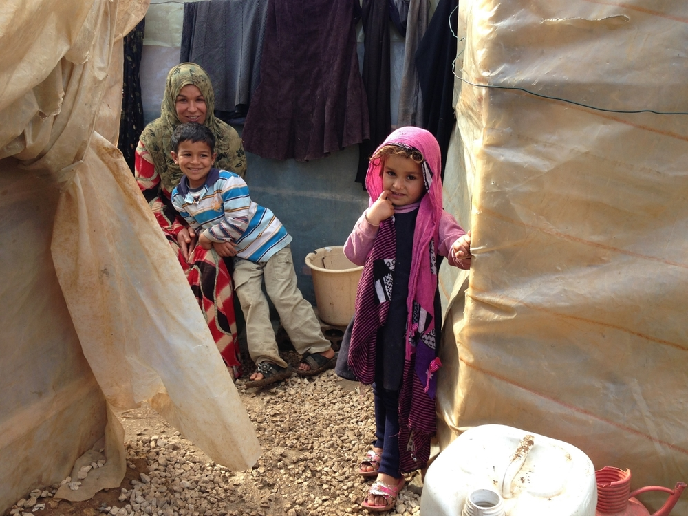 A family of Syrian refugees in a makeshift camp north of the Lebanese city of Tripoli © Ruth Pollard 2014