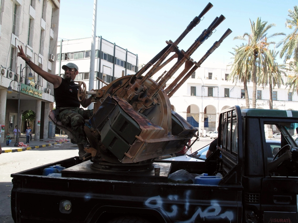 A jubilant Libyan rebel marks liberation of Tripoli.© Ruth Pollard 2011