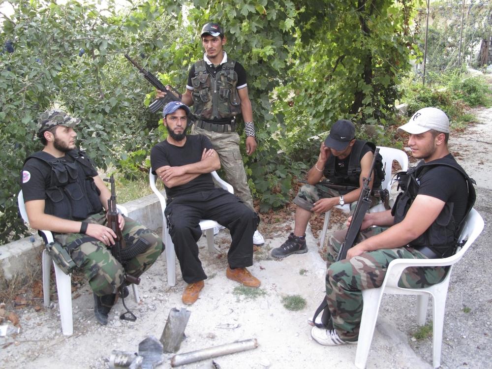 Free Syrian Army fighters take a break near Salma, Syria. ©Ruth Pollard 2012