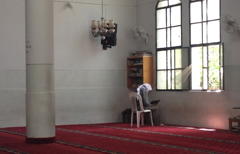 A solo worshipper in a Sunni mosque in Baalbek, Lebanon. ©Ruth Pollard 2015