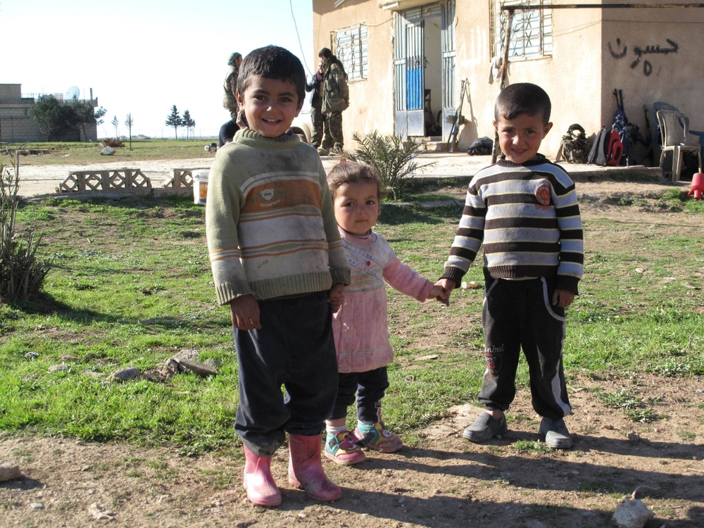 Young Syrian children in a village recently liberated from ISIS. ©Ruth Pollard 2015