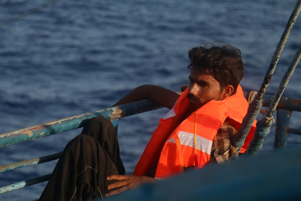 An exhausted man awaits rescue from a stricken boat off the coast of Libya. ©Ruth Pollard 2015