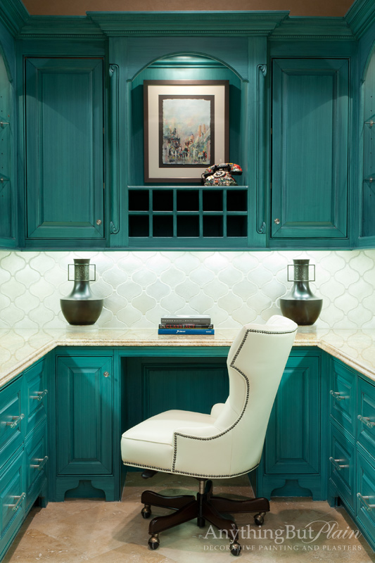 Although this isn't exactly green we're going to count it because its one our absolute favorite colors and projects. Who wouldn't get the most out of the work day with a vibrantly glazed cabinets like these!