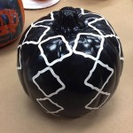 Stickers applied to spray painted pumpkin to create design.