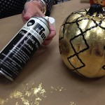 Varnishing black pumpkin