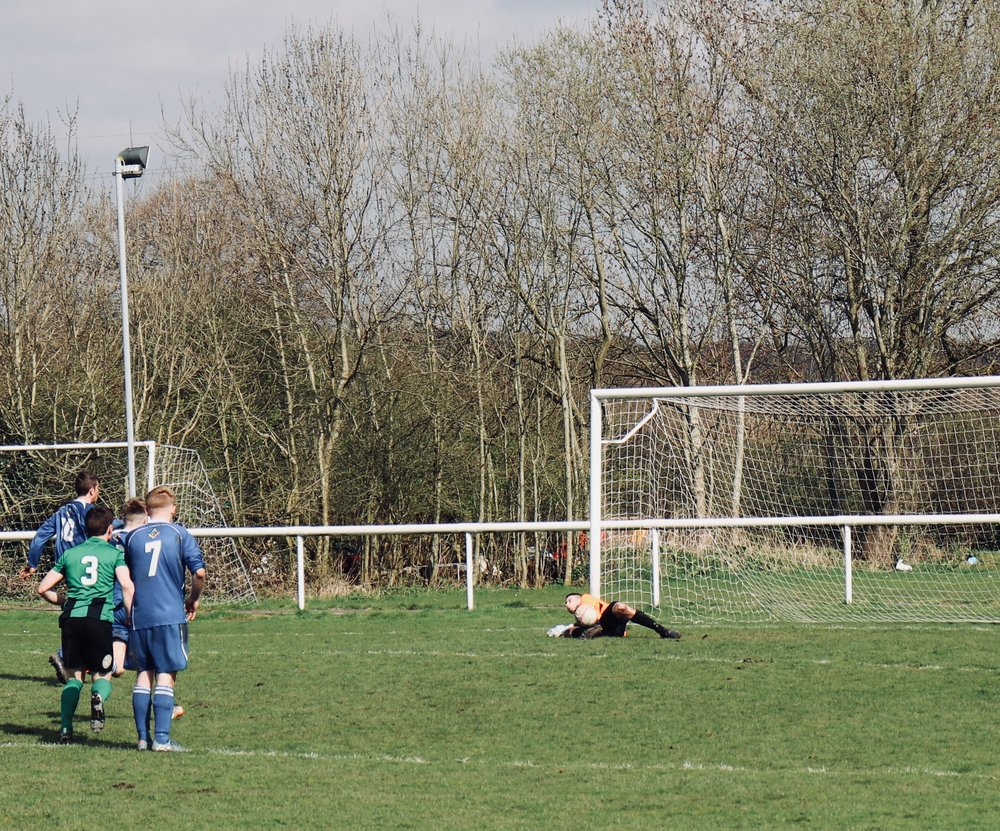 Danny Whiting gets down to save the penalty....