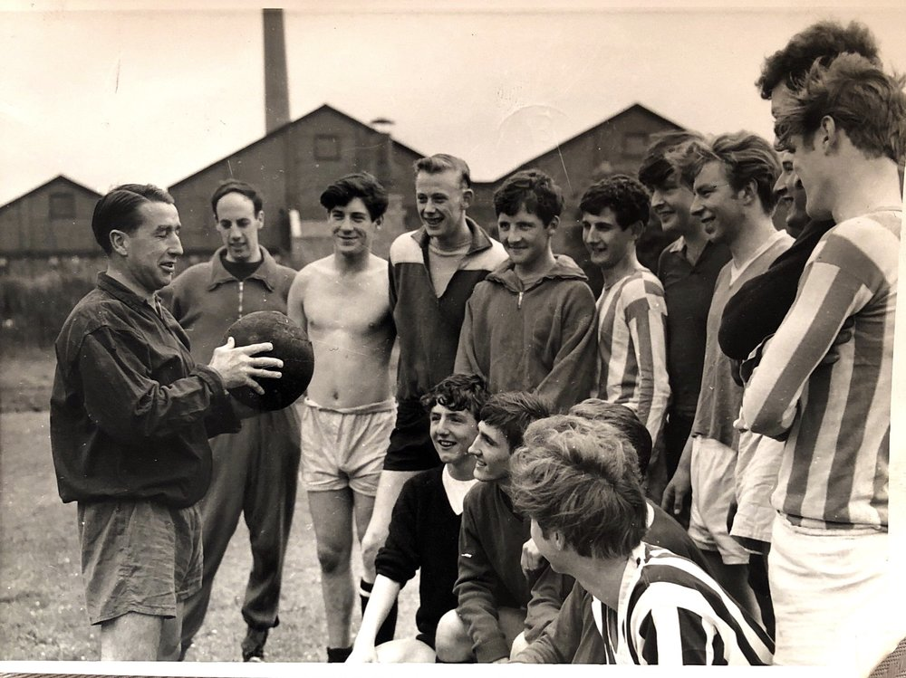 Manchester United winghalf Harry Cockburn gives the players some advice ahead of their trip to Barcelona in 1964.