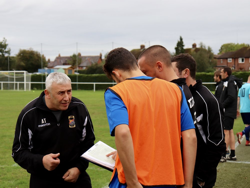 Substitute Callum Knight receives his instructions