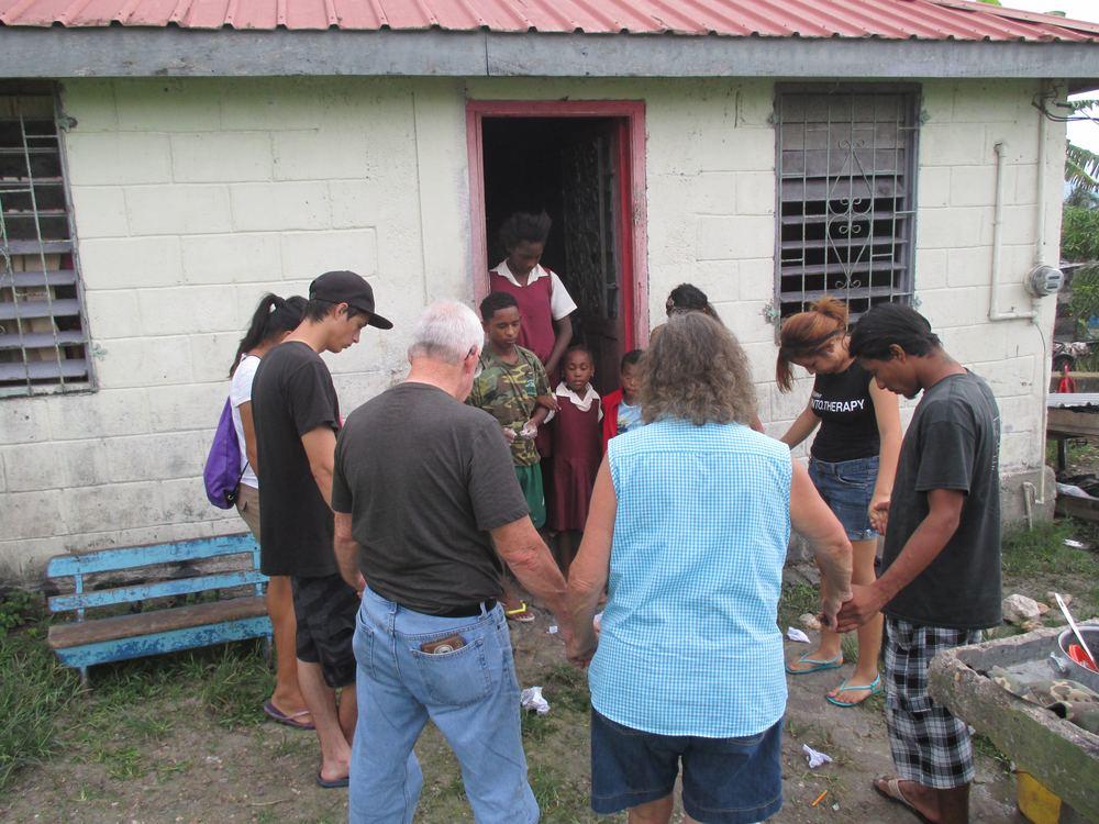 Praying for a family in Santiago Juan