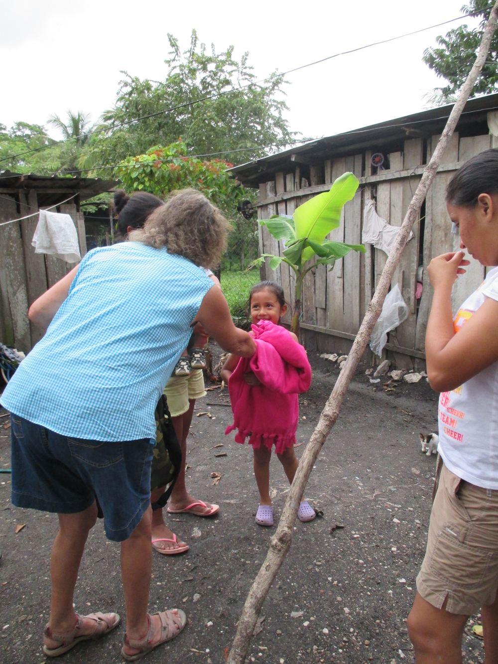 Giving blankets to children in San Ignacio, Belize