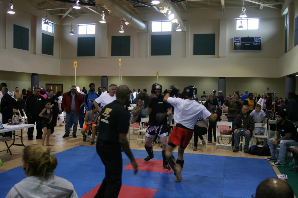 Bill (black shirt) in a Muay Thai tournament