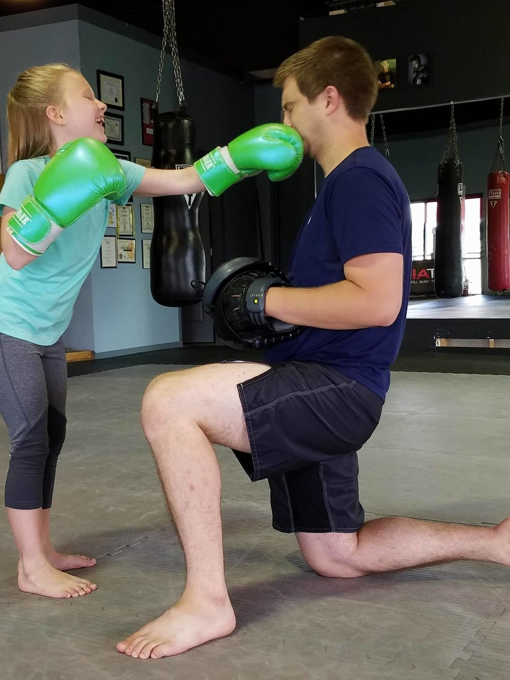Confidence through Fun - Watch your child's confidence soar while learning awesome self-defense and life skills!