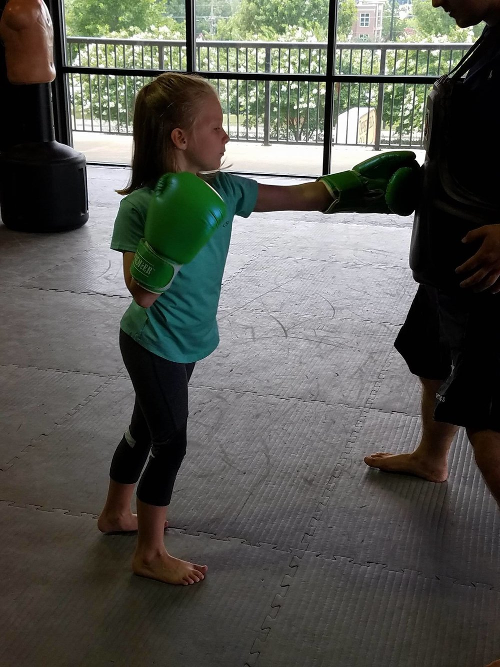 Striking - Kids learn how to safely strike, either punching and kicking mitts or the heavy bag.
