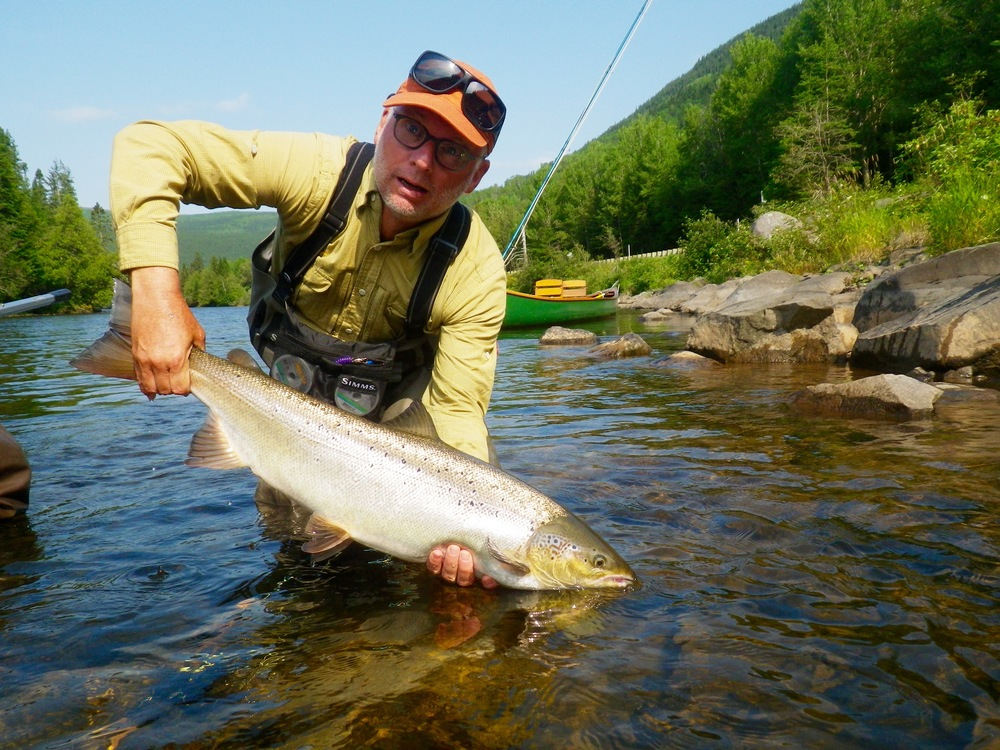 Maurice Perret lands his first Grand Cascapedia salmon of the week, nice one Maurice!