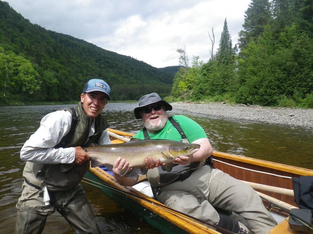 Julian Stoudemiere with Salmon Lodge guide Charles Binette on the Grand, Nice one Julian!!!