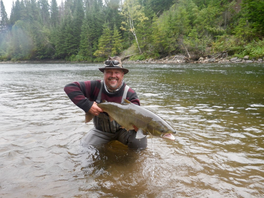 Salmon Lodge Guide Yvan Bernard releases one back to swim again!