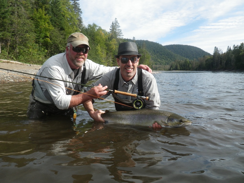 Jeff McDonald and Salmon Lodge Guide Larry put one back on the Grand Cascapedia, nice salmon Jeff!