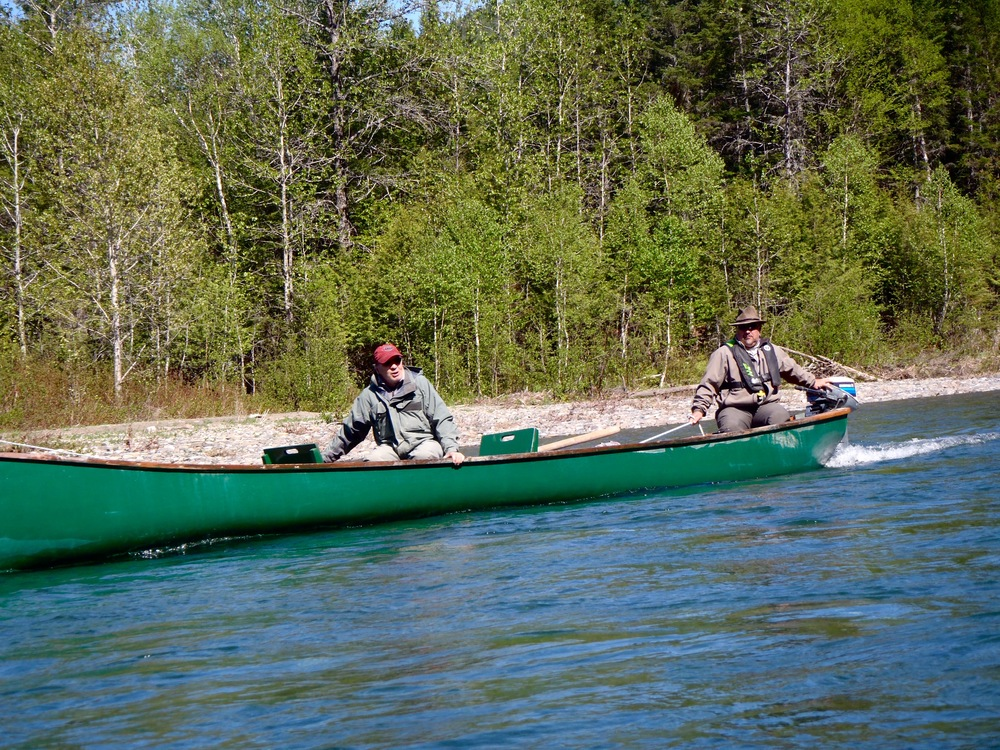 Salmon Lodge guides, Clement and Yvan scouting the Bonaventure for salmon.