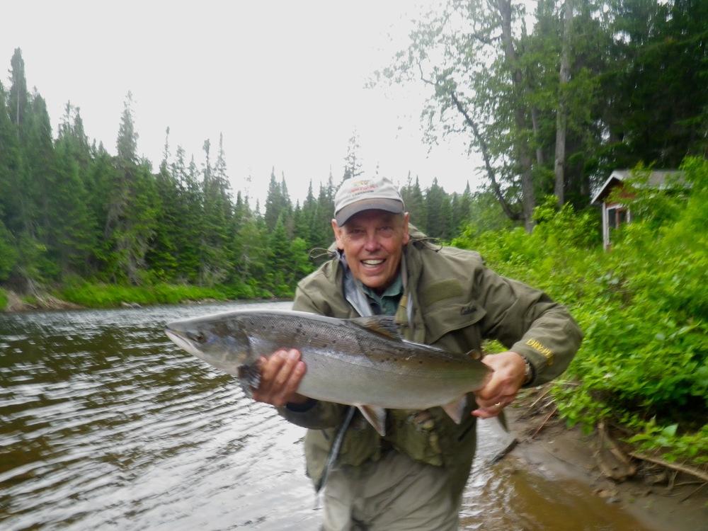 Salmon Lodge regular David McFarlaine with his first Grand Cascapedia salmon of the season, Nice fish David!