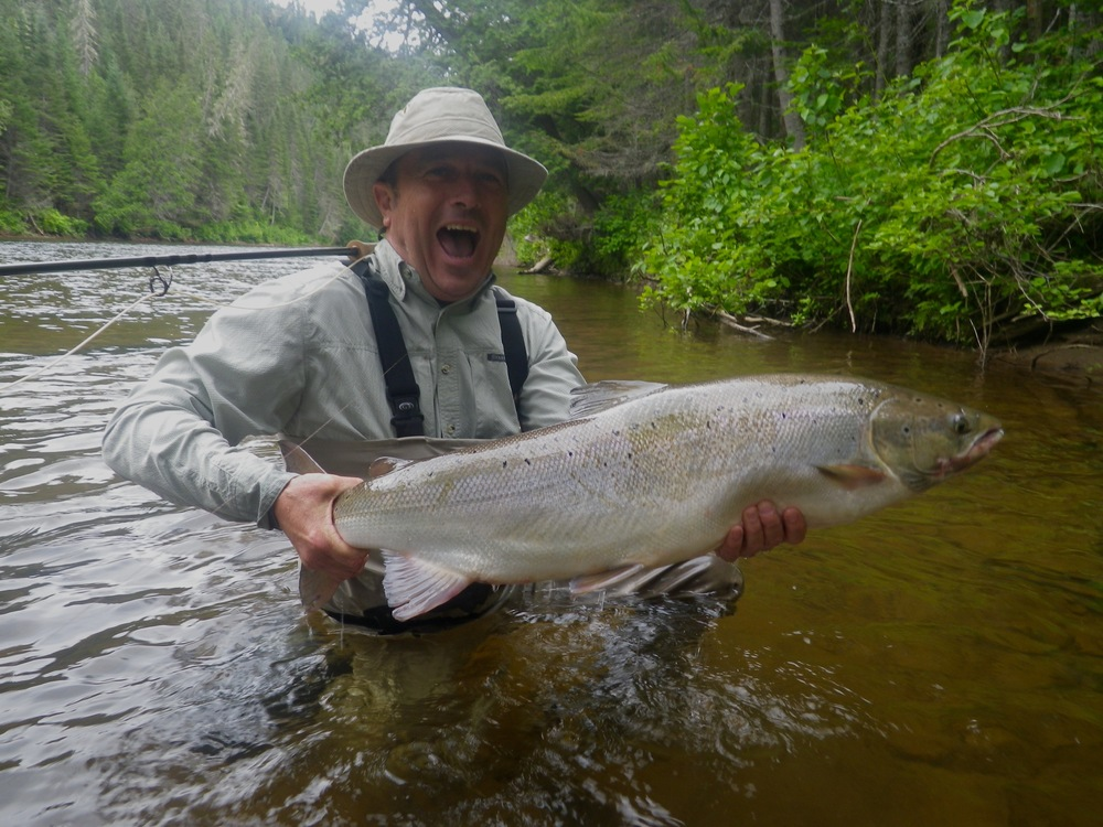 A happy angler indeed! Claude Lachance landed this beauty on the Grand Cascapedia, Congratulations Claude!