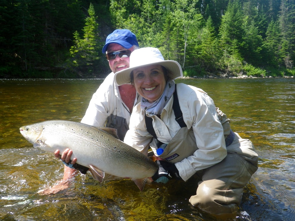 Kim Pilon lands her first Atlantic salmon with Salmon Lodge guide Larry Dee, Nice fish Kim!