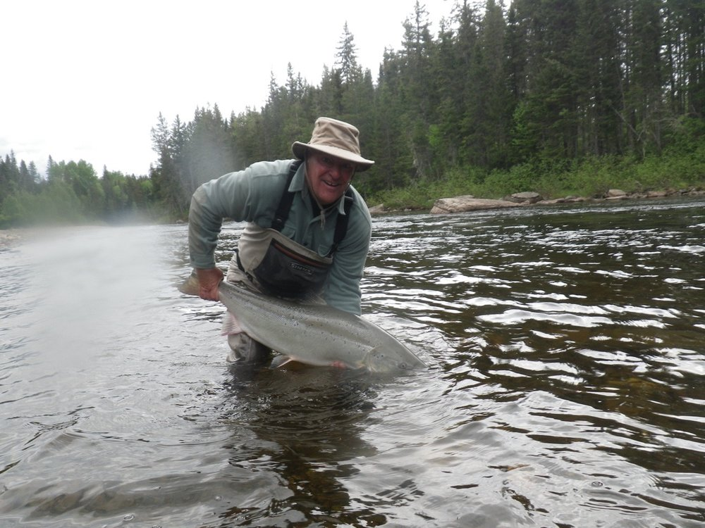 Salmon Lodge regular Claude Berger with a nice big Grand Cascapedia salmon, congratulations Claude!